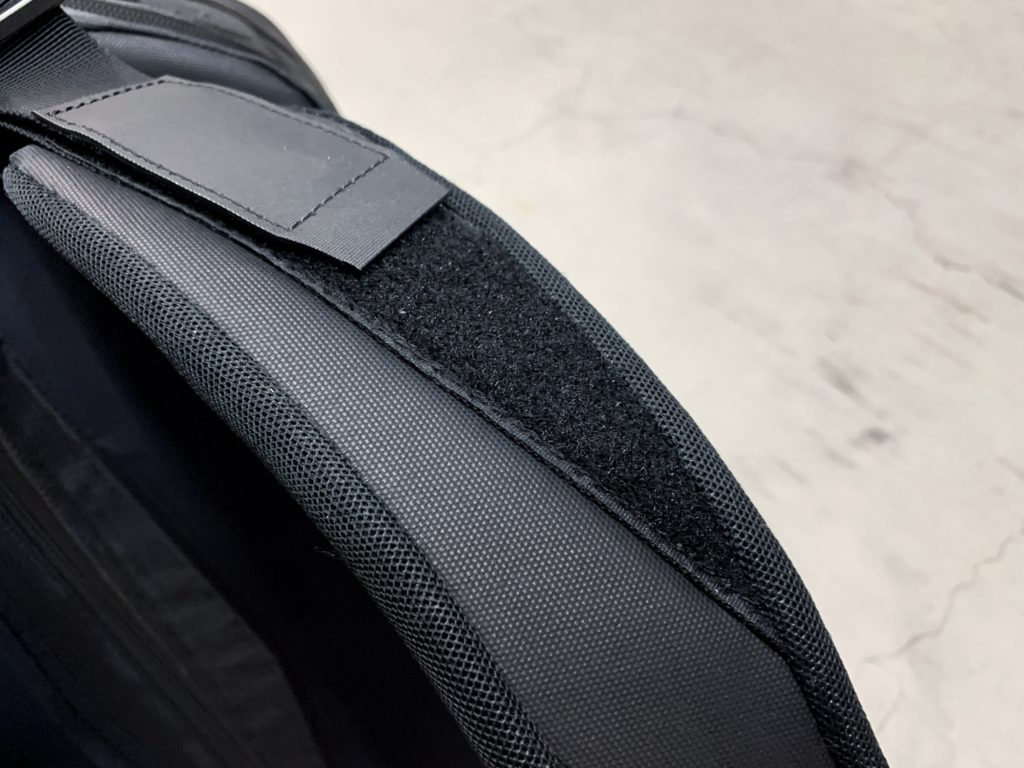 The velcro takes a little away from the clean black minimalist backpack look.