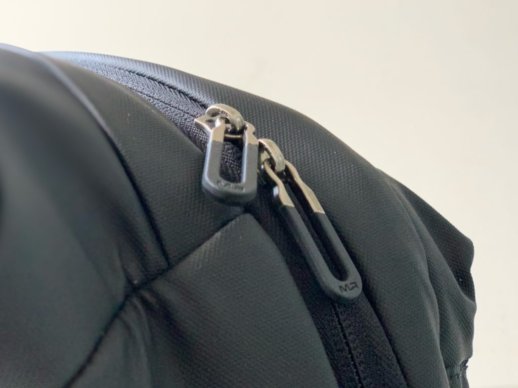 YKK zippers is replaced by SBS zippers to make this the perfect cheap backpack for travel.