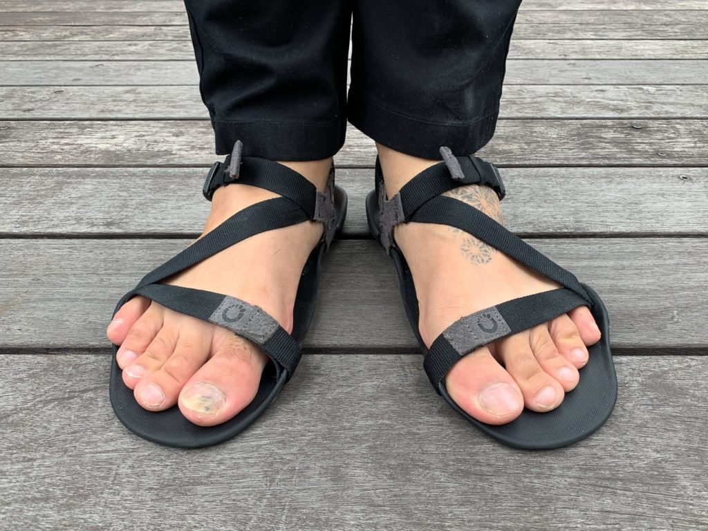 Remember to let your feet breath with a pair of minimal sandals when deciding what to wear on a plane in Summer