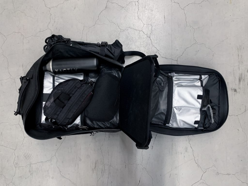 A black minimalist backpack with brilliant design details and organization. What more could you as for?