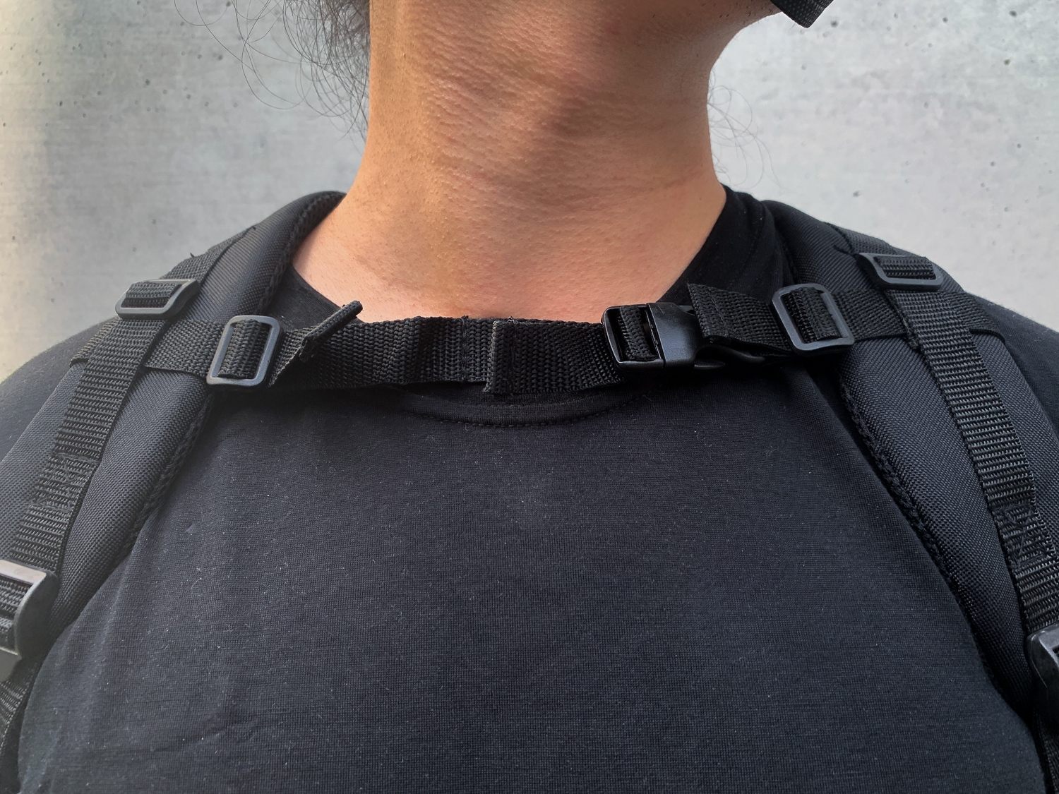 If you wear the straps too loose, the sternum strap comes up to your neck, which is typical for military backpacks which are designed for stability with heavy loads.