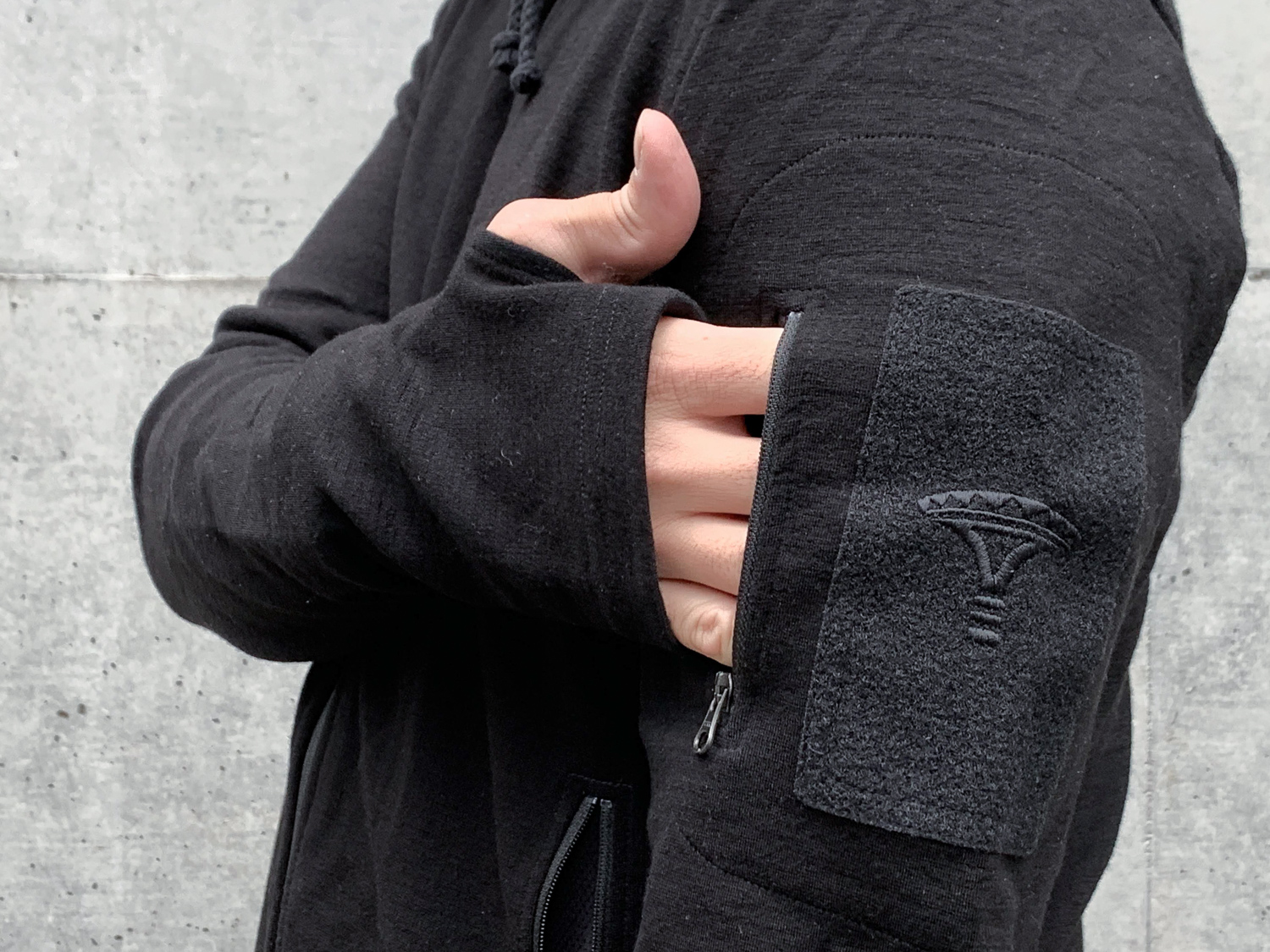 A black hoodie with more than enough pockets.