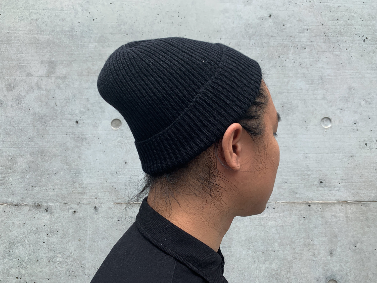A wool watch cap that is sized enough fits your head, but not too loose that it comes out easily.