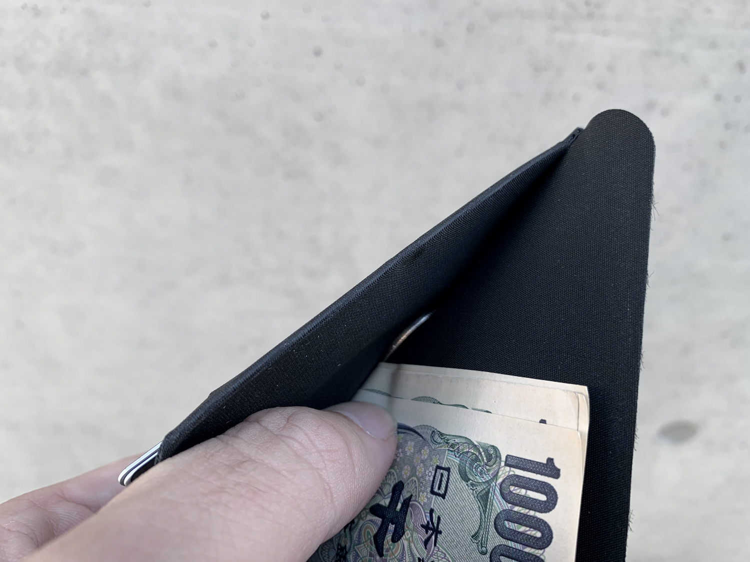 A bifold wallet means no coins compartment.