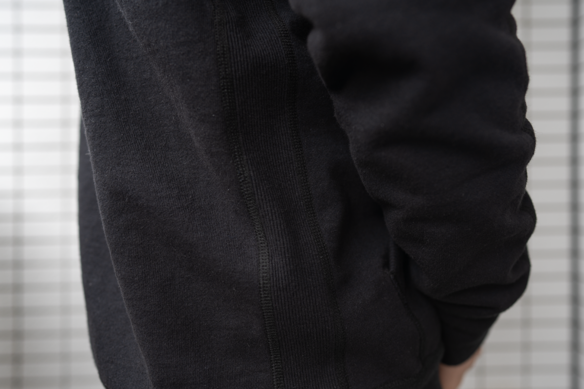 Side rib panels on the Reigning Champ Full Zip Hoodie that offer better freedom of movement