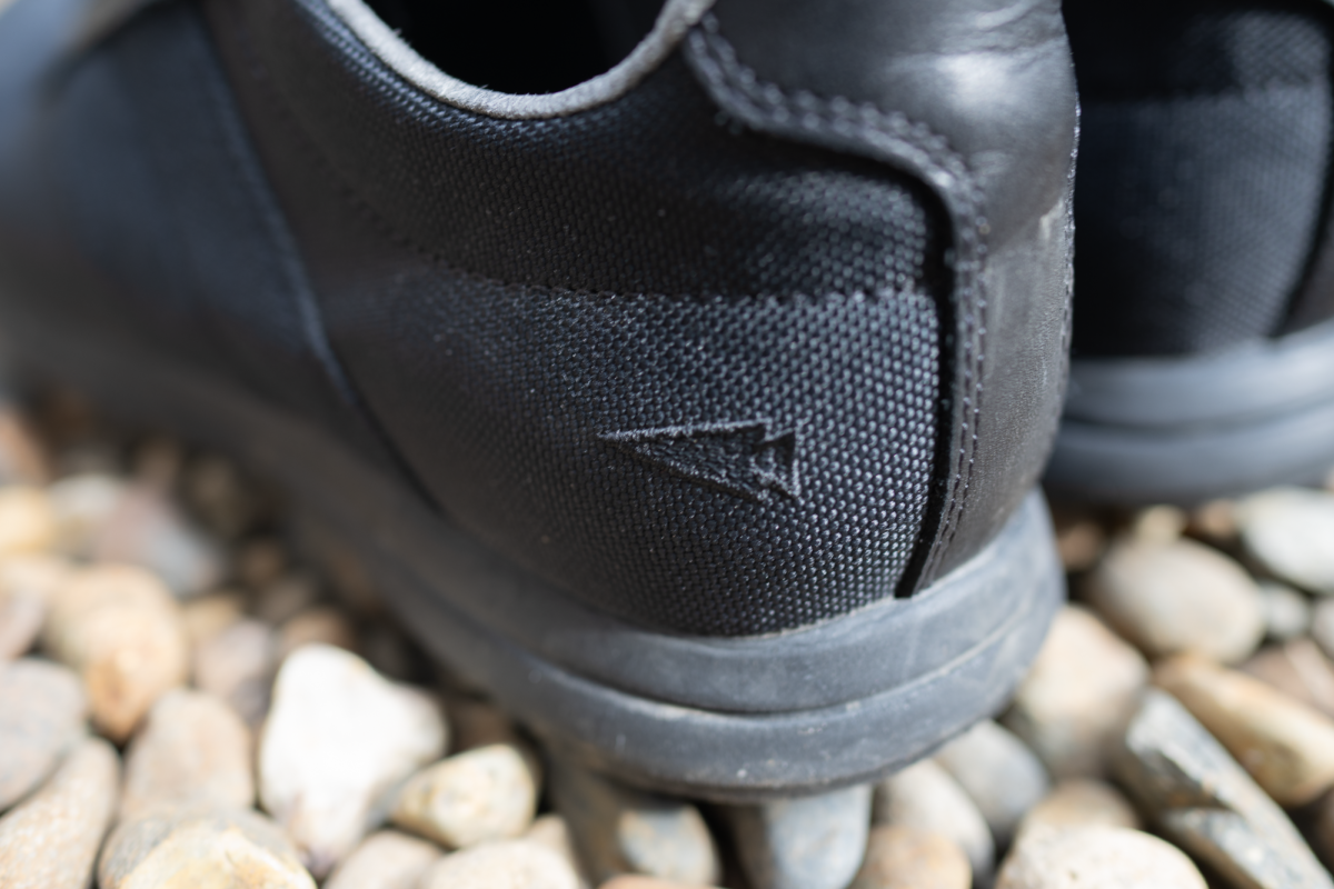 Subtle embroidered arrowhead logo on the GORUCK I/O Cross Trainers.