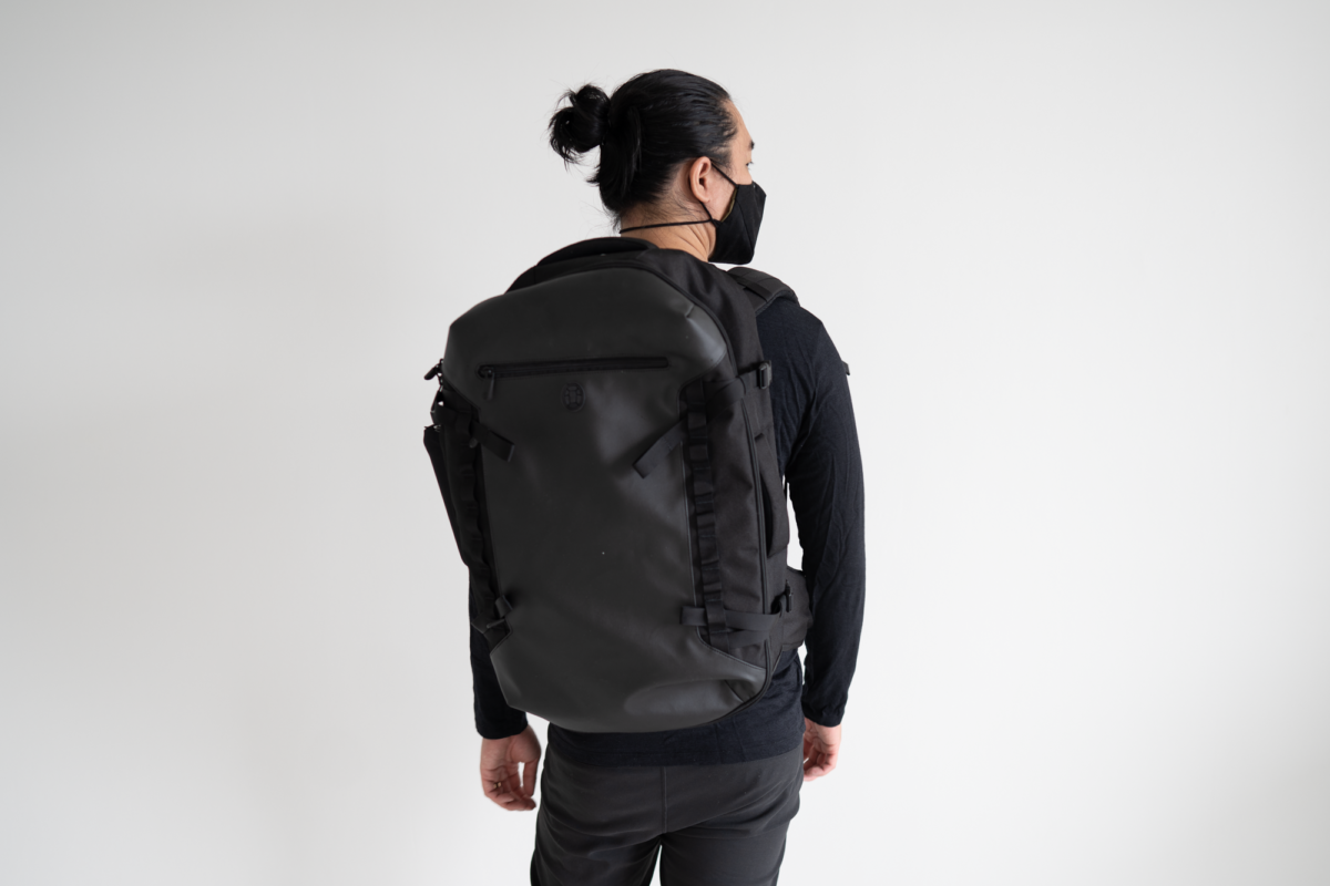 With the TOM BIHN Face Mask, Tortuga Prelude Travel Backpack, Wool&Prince Henley, and Outlier Futuredarts.