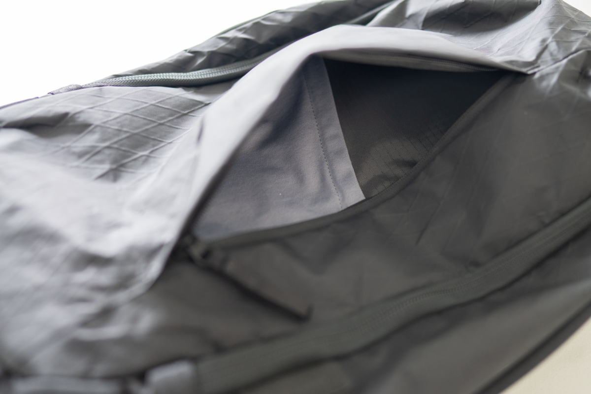 Front panel pocket on the Able Carry Max Backpack.