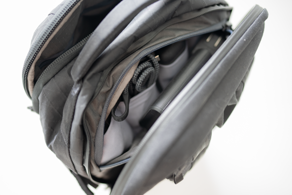 This compartment on the Able Carry Max Backpack is great as a tech pouch.