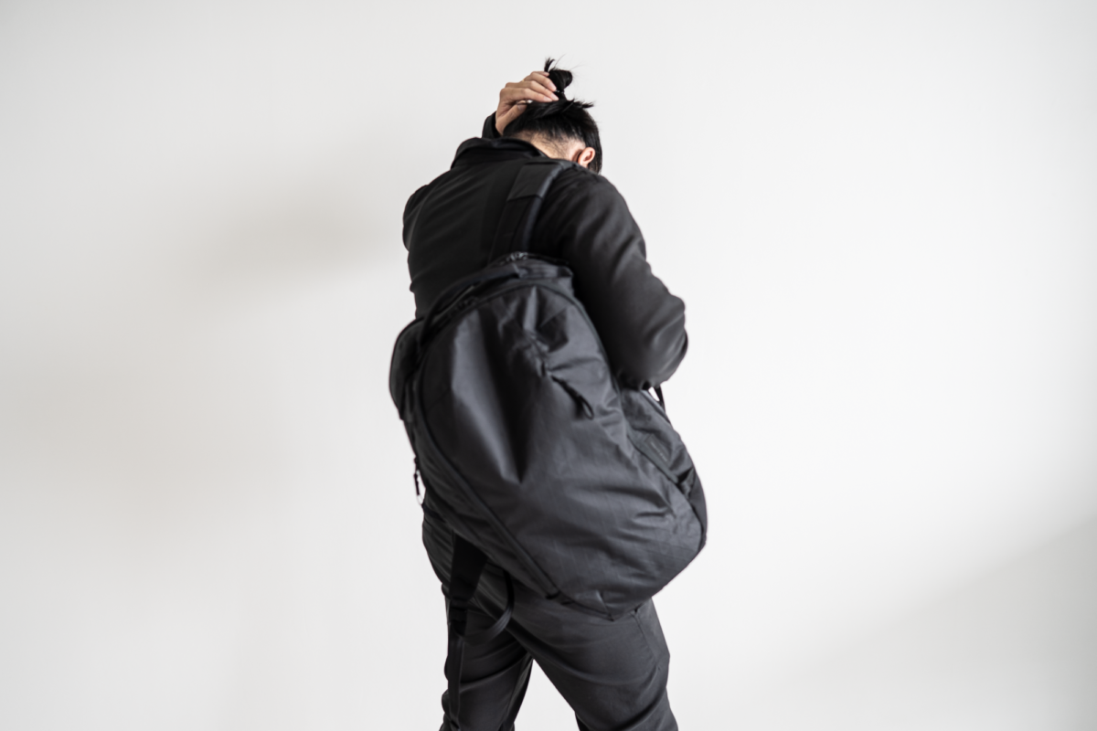 With the Outlier Hard Shirt, Outlier Futuredarts, and Able Carry Max Backpack.