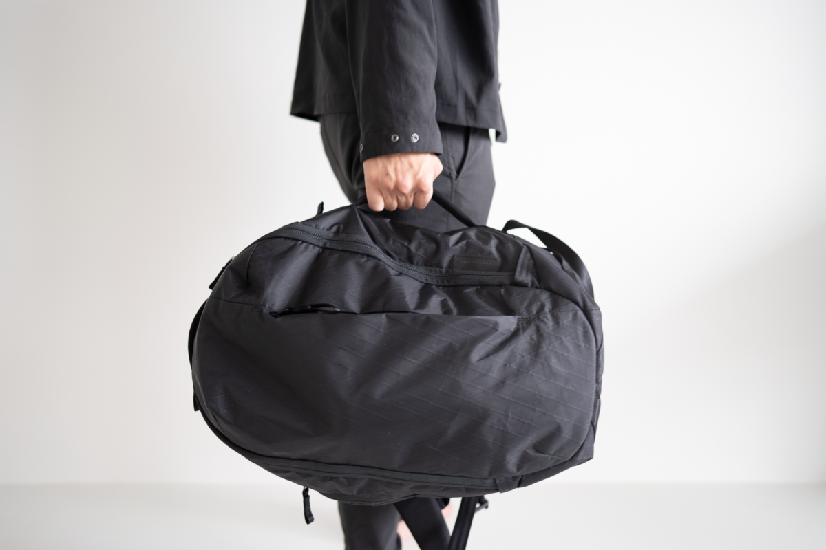Carrying the Able Carry Max Backpack briefcase mode.