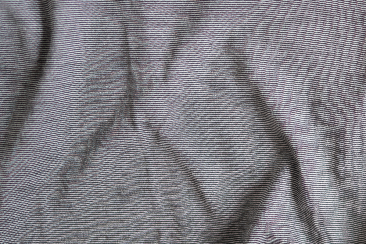 Close-up on the pattern of the Wool&Prince Pocket Tee.