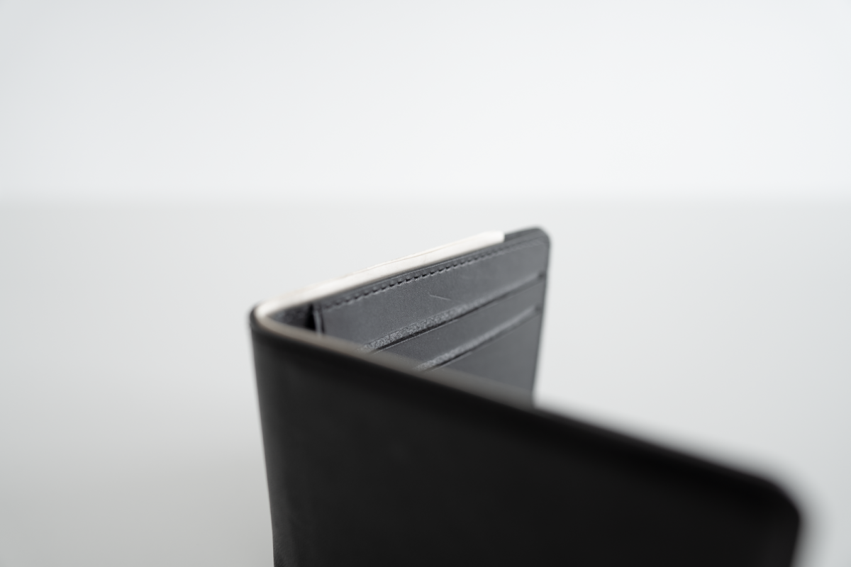 Japanese yen peeks out of the NOMAD Bifold Wallet.